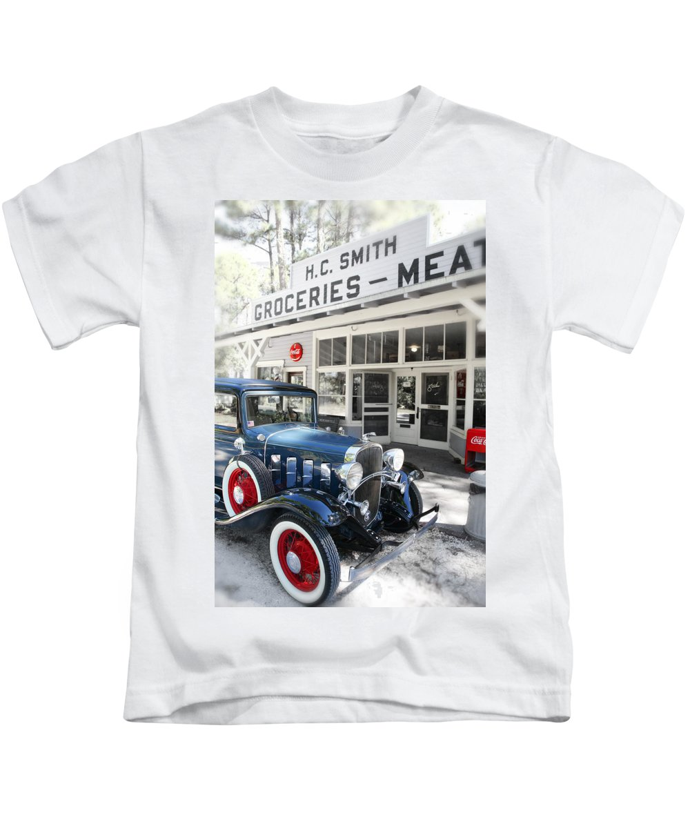 Chevy Kids T-Shirt featuring the photograph Classic Chevrolet Automobile Parked Outside The Store by Mal Bray