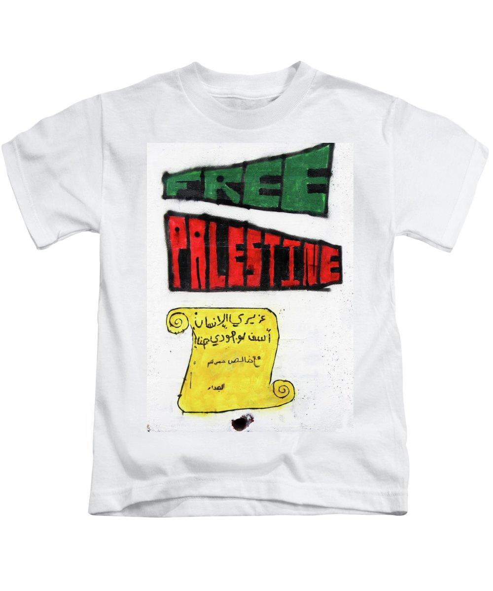 Free Palestine Kids T-Shirt featuring the photograph Dear Human by Munir Alawi