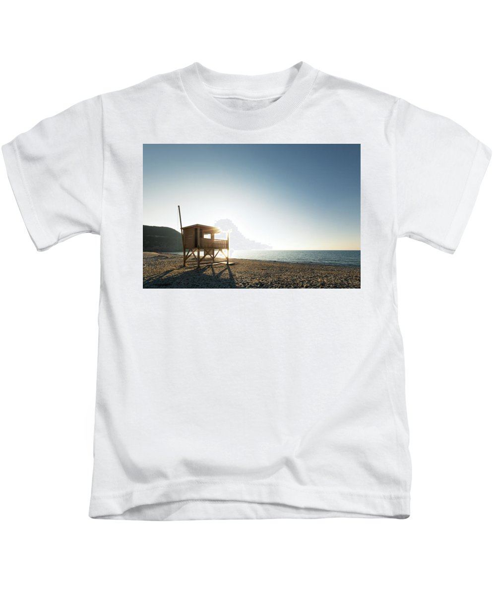 Balagne Kids T-Shirt featuring the photograph Evening Sun On Lifeguard Tower On Ostriconi Beach In Corsica by Jon Ingall