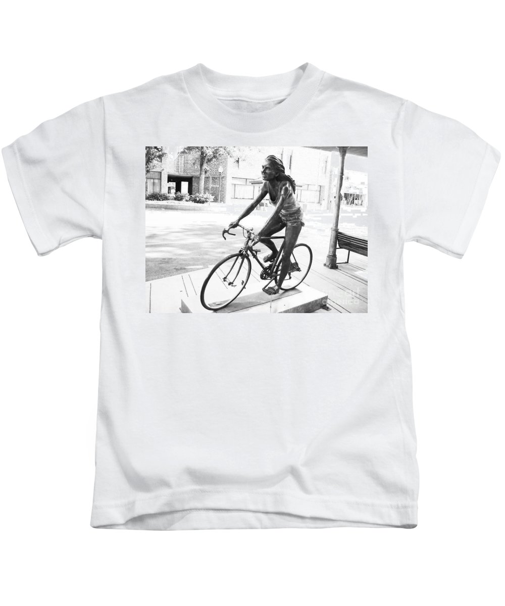 Girl On Bike Sculpture Grand Junction Kids T-Shirt featuring the photograph Girl On Bike Sculpture Grand Junction Co by Tommy Anderson
