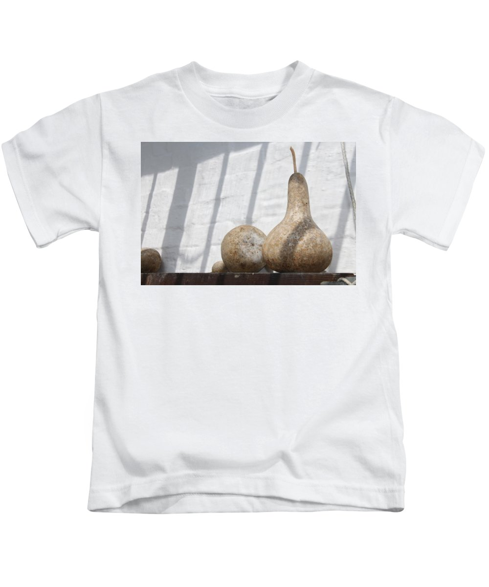 Gourds Kids T-Shirt featuring the photograph Gourds In Shadow by Lauri Novak