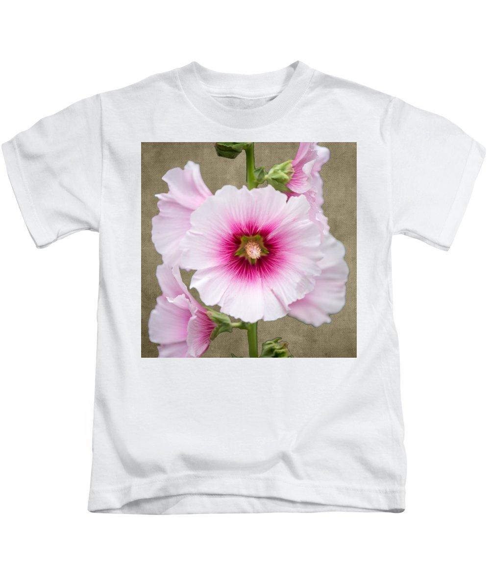 Flower Kids T-Shirt featuring the photograph Hollyhock On Linen by Roy Pedersen