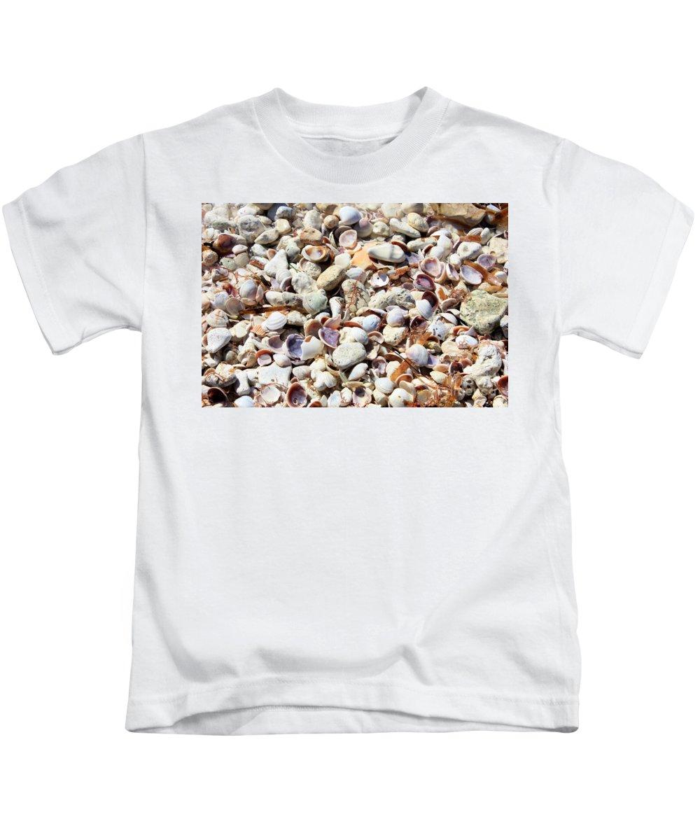 Shells Kids T-Shirt featuring the photograph Honeymoon Island Shells by Carol Groenen