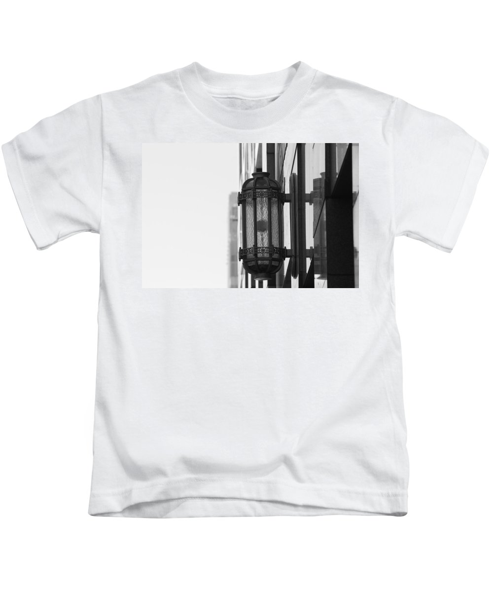 Architecture Kids T-Shirt featuring the photograph Lamp On The Wall by Rob Hans