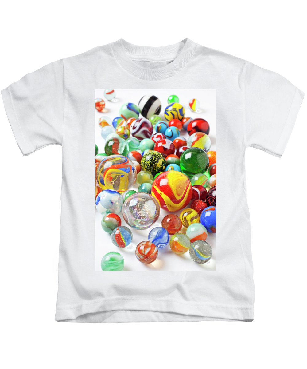 Marble Marbles Many Pile Shooter Shooters Round Glass Toy Toys C Kids T-Shirt featuring the photograph Many Marbles by Garry Gay