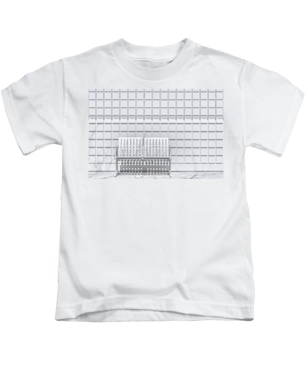Bench Kids T-Shirt featuring the photograph Metal Bench Against Concrete Squares by Scott Norris