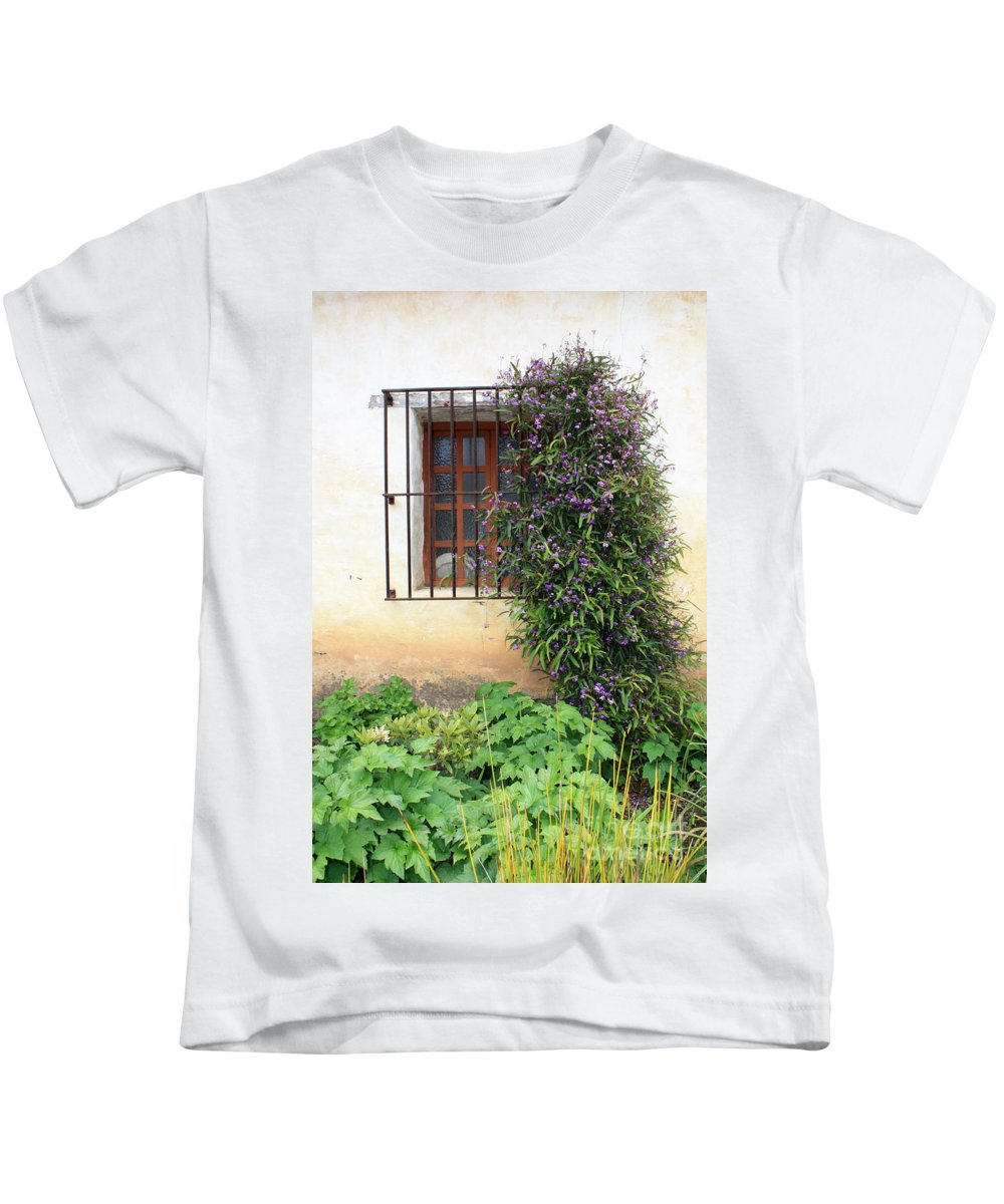 Mission Kids T-Shirt featuring the photograph Mission Window With Purple Flowers Vertical by Carol Groenen