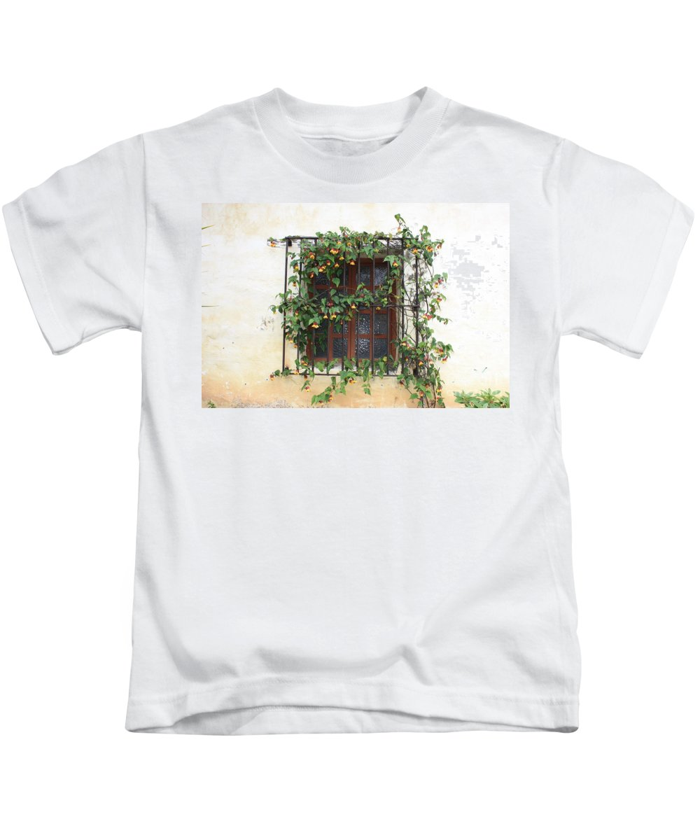 Window Kids T-Shirt featuring the photograph Mission Window With Yellow Flowers by Carol Groenen