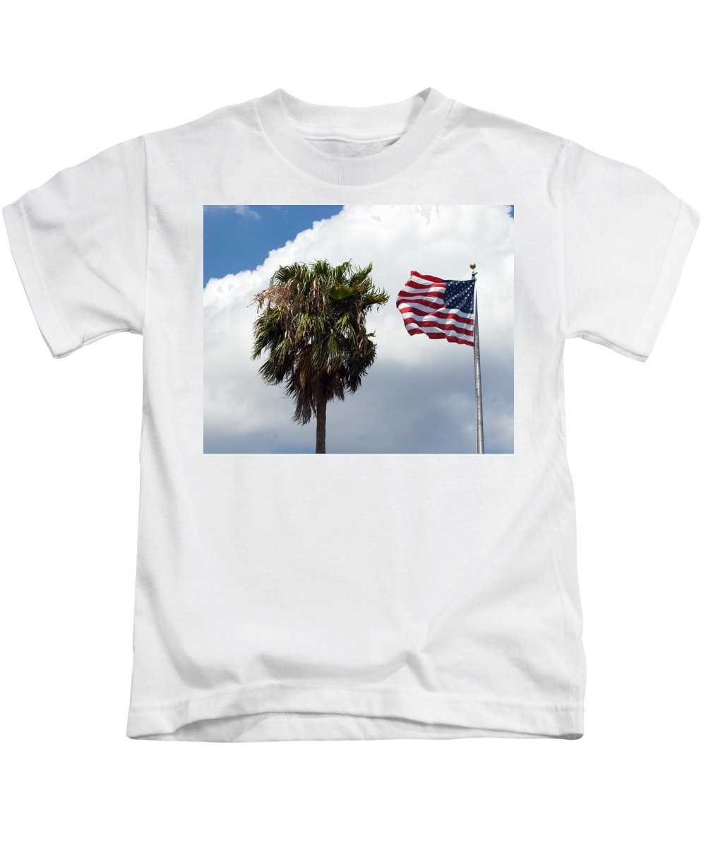 Florida; Titusville; Space; Coast; Astronauts; Astronaut; Cape; Canaveral; Mercury; Project; Freedom Kids T-Shirt featuring the photograph Old Glory Monument At Titusville Florida by Allan Hughes