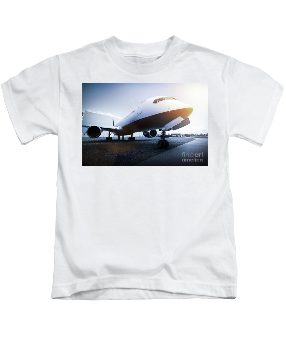 Airplane Kids T-Shirt featuring the photograph Passenger Airplane On The Airport Parking by Michal Bednarek