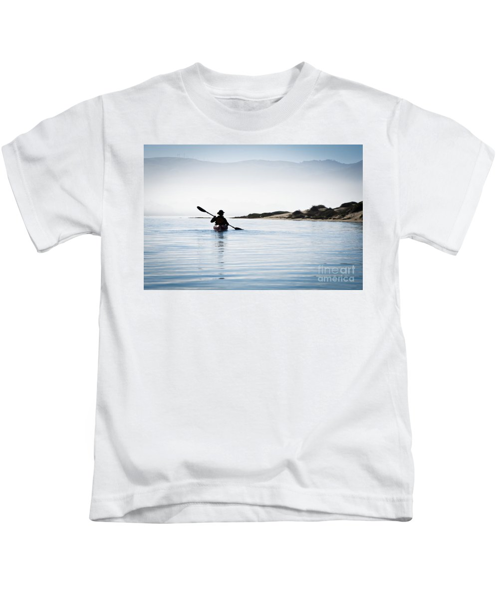 Active Kids T-Shirt featuring the photograph Silhouetted Kayaker In Morro Bay by Bill Brennan - Printscapes