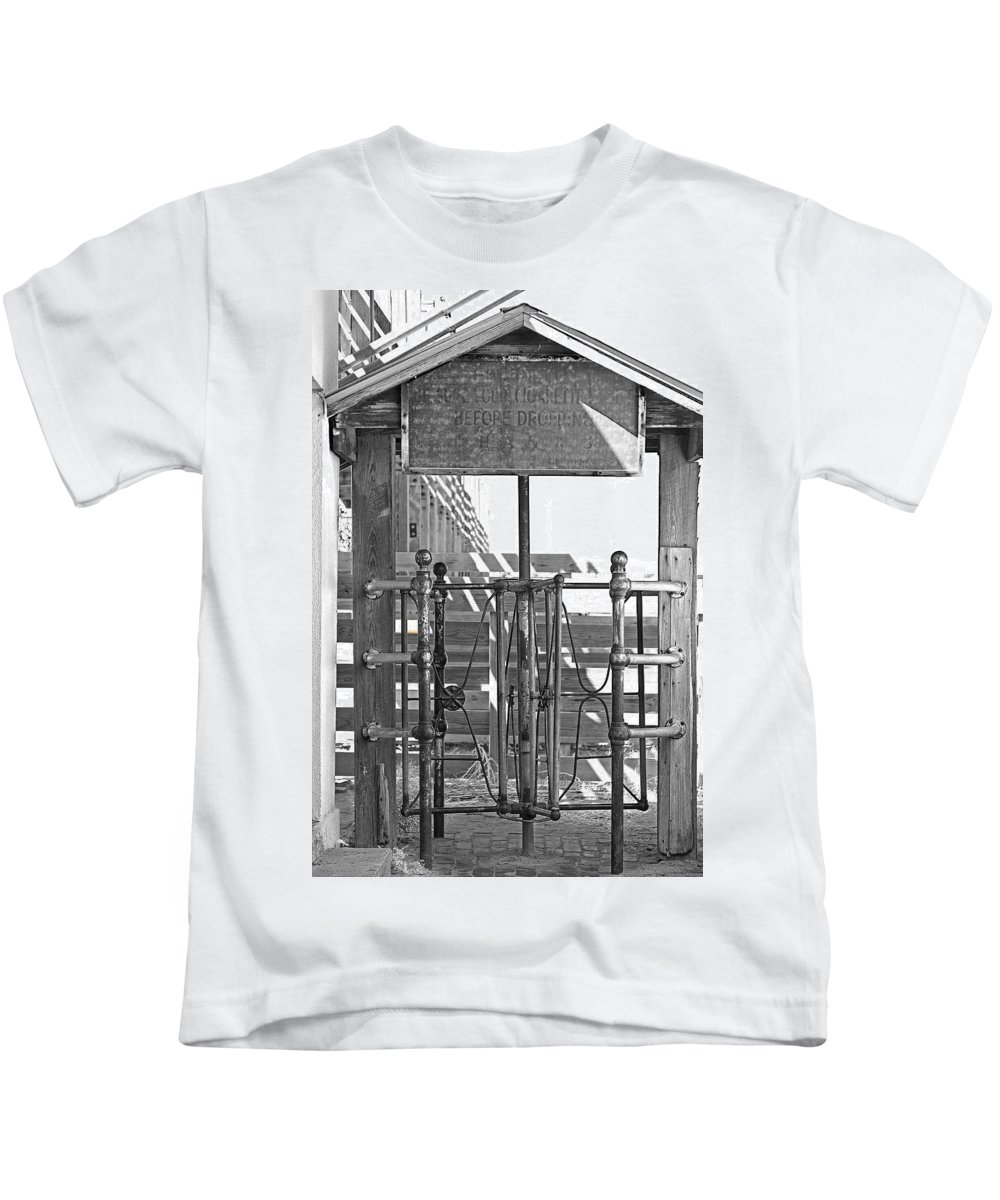 Gate Kids T-Shirt featuring the photograph Stockyard Gate Black And White by Austin Photography