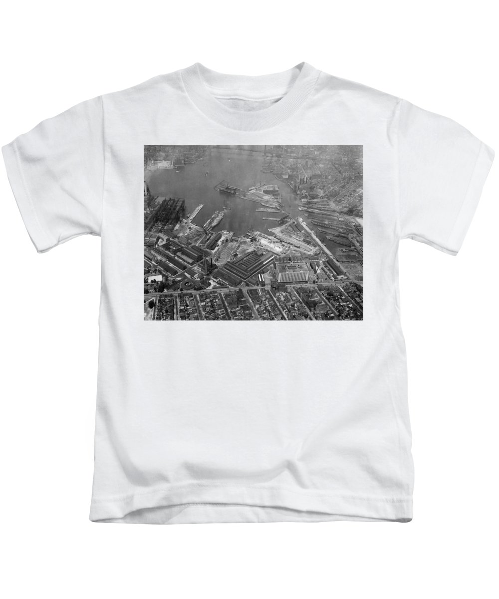 Naval Yard Kids T-Shirt featuring the photograph U.s. Naval Yard In Brooklyn Ny Photograph - 1932 by PhotographyAssociates