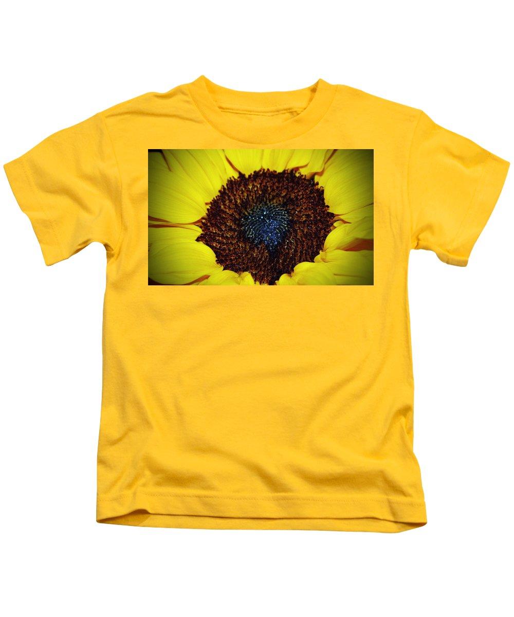Sunflower Kids T-Shirt featuring the photograph Center Of A Sunflower by Cynthia Guinn