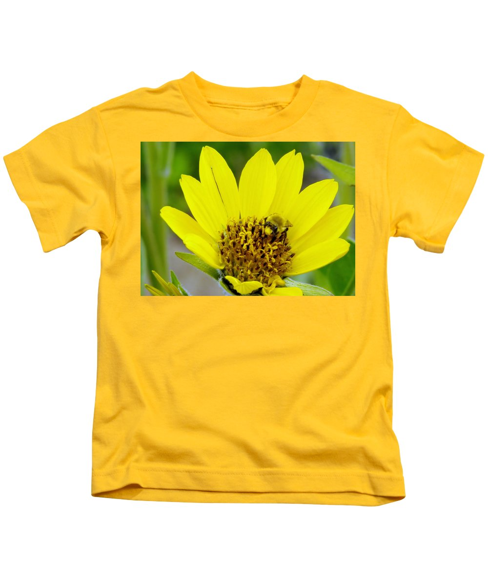 Bees Kids T-Shirt featuring the photograph A Bumble Hunkering Down by Jeff Swan