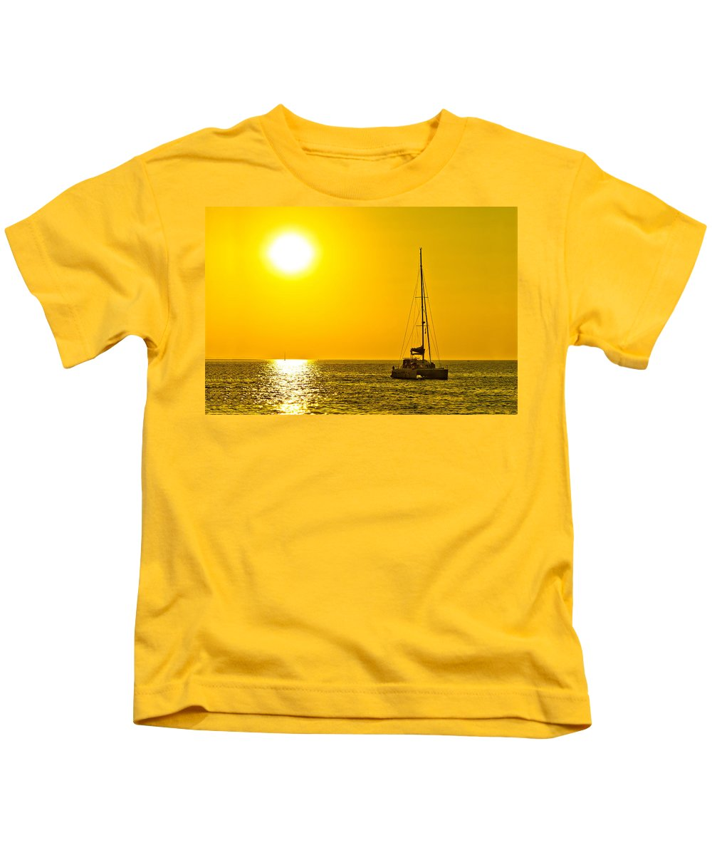 Gold Kids T-Shirt featuring the photograph Catamaran Sailboat On Golden Sunset by Brch Photography