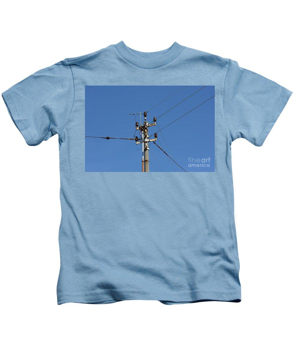 Electricity Pylon Kids T-Shirt featuring the photograph Electric Pylon by Mats Silvan
