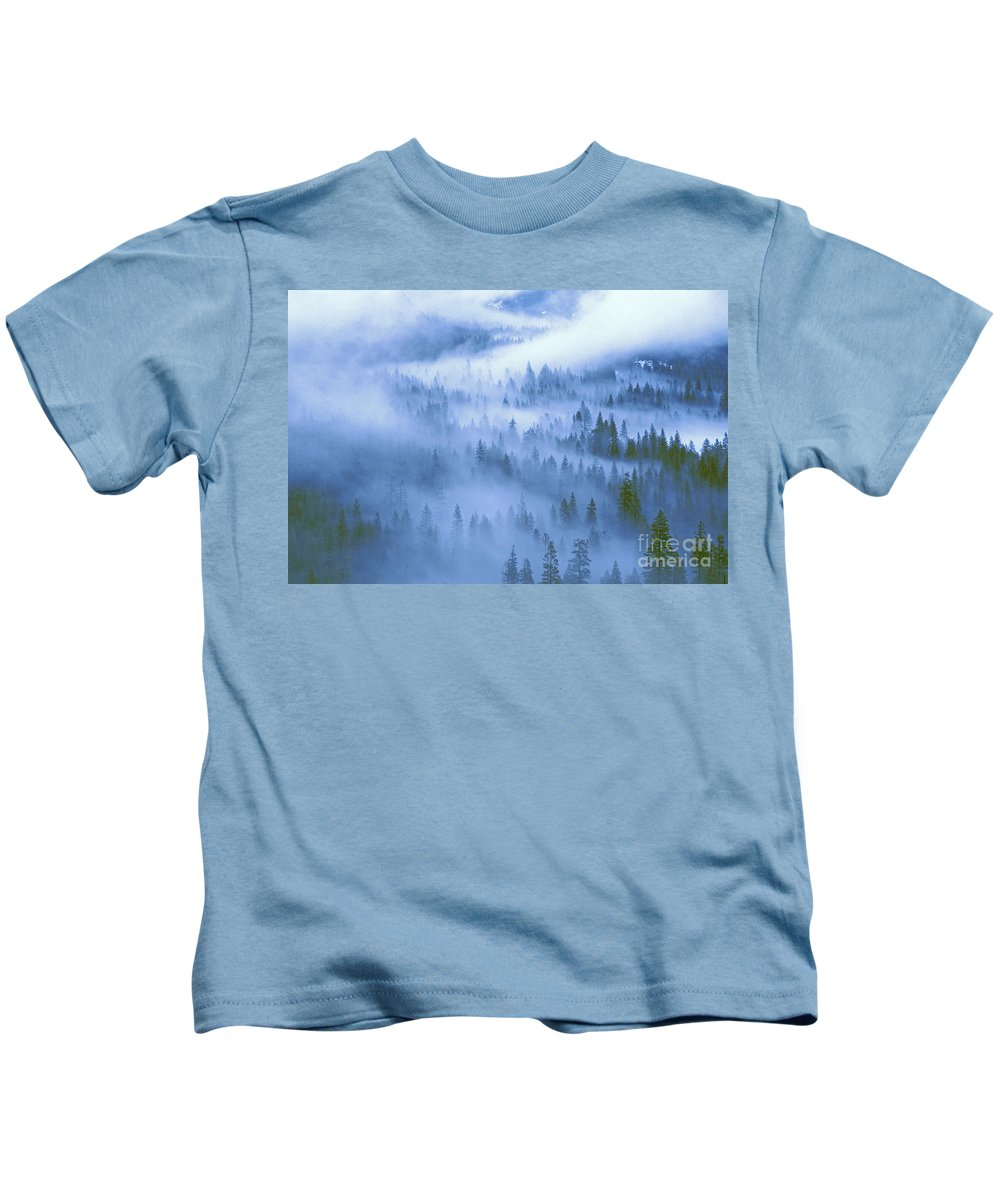 North America Kids T-Shirt featuring the photograph Fir Trees Shrouded In Fog In Yosemite Valley by Dave Welling