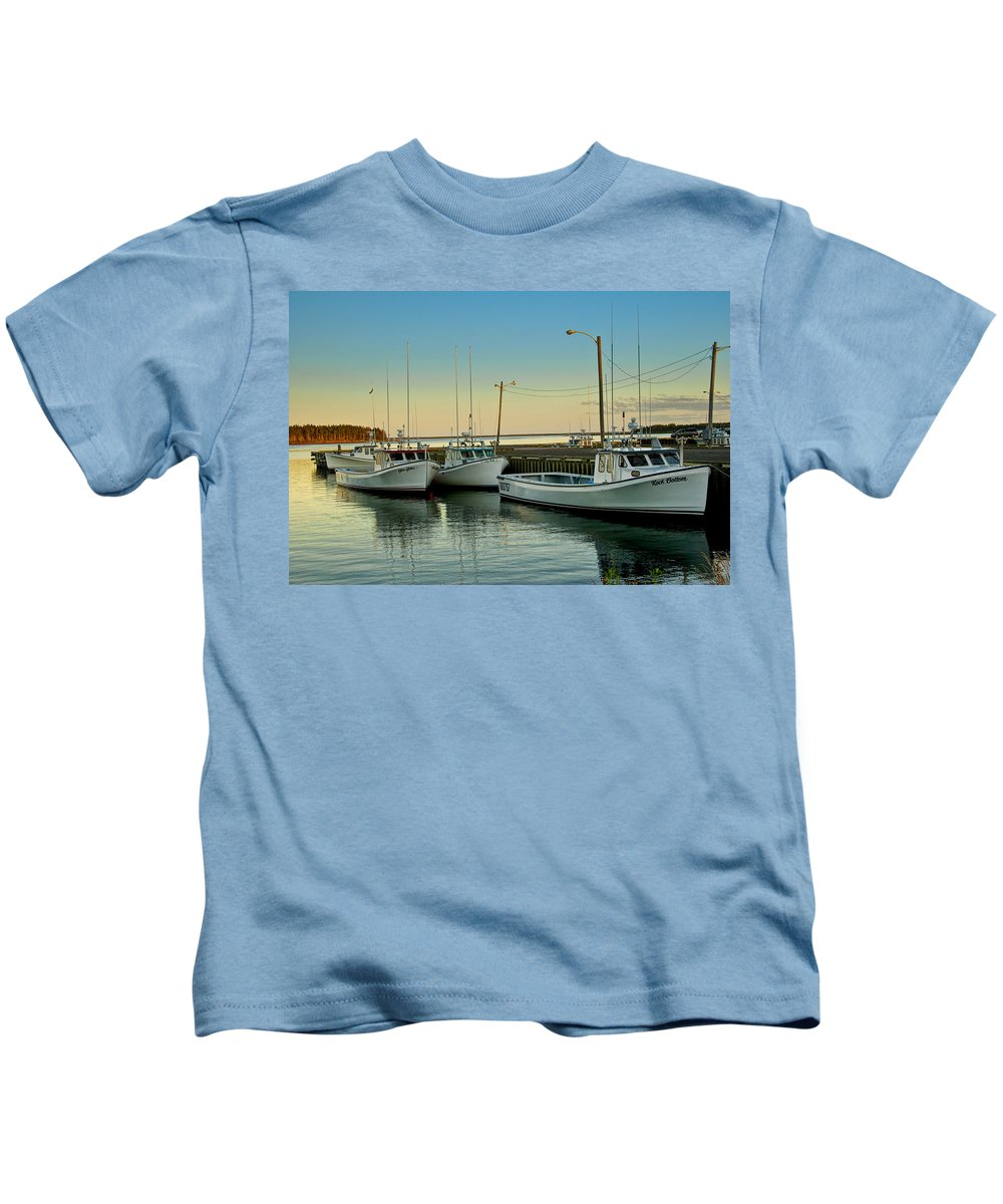 Boats Kids T-Shirt featuring the photograph Fishing Boats In A Harbor Towards Evening On Prince Edward Island by Randall Nyhof