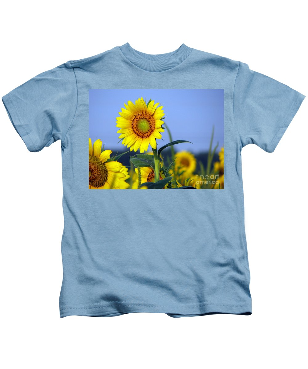 Sunflower Kids T-Shirt featuring the photograph Getting to the sun by Amanda Barcon