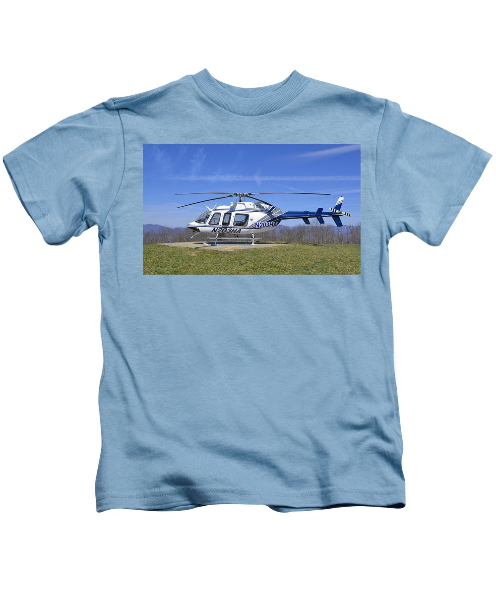 Helicopter Kids T-Shirt featuring the photograph Helicopter On A Mountain by Susan Leggett