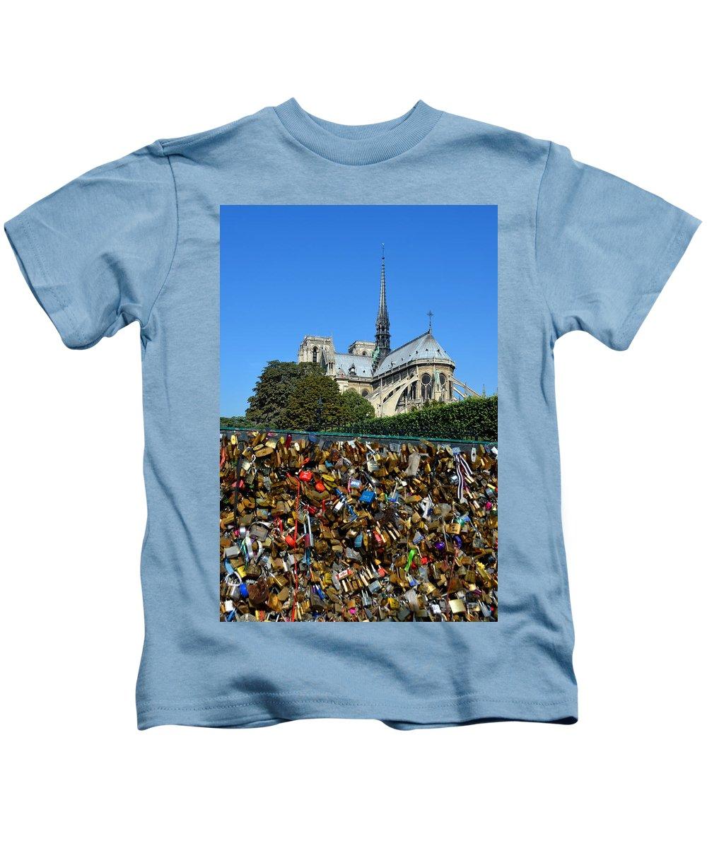 Notre Dame Cathedral Kids T-Shirt featuring the photograph Locks Galore On The Pont De L'archeveche In Paris by Carla Parris