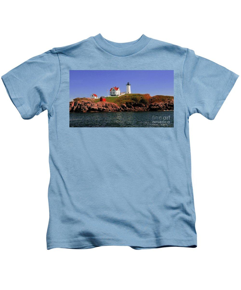 #nubble #lighthouse #maine Kids T-Shirt featuring the photograph Nubble Lighthouse-cape Neddick by Kathleen Struckle