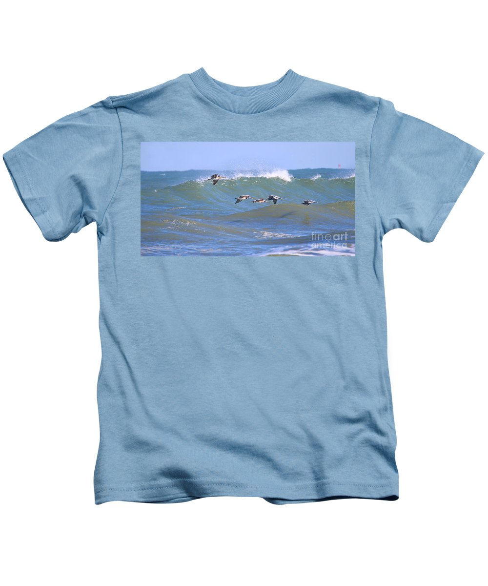 Pelicans Kids T-Shirt featuring the photograph Pelicans Flying Between Waves 3788 by Jack Schultz