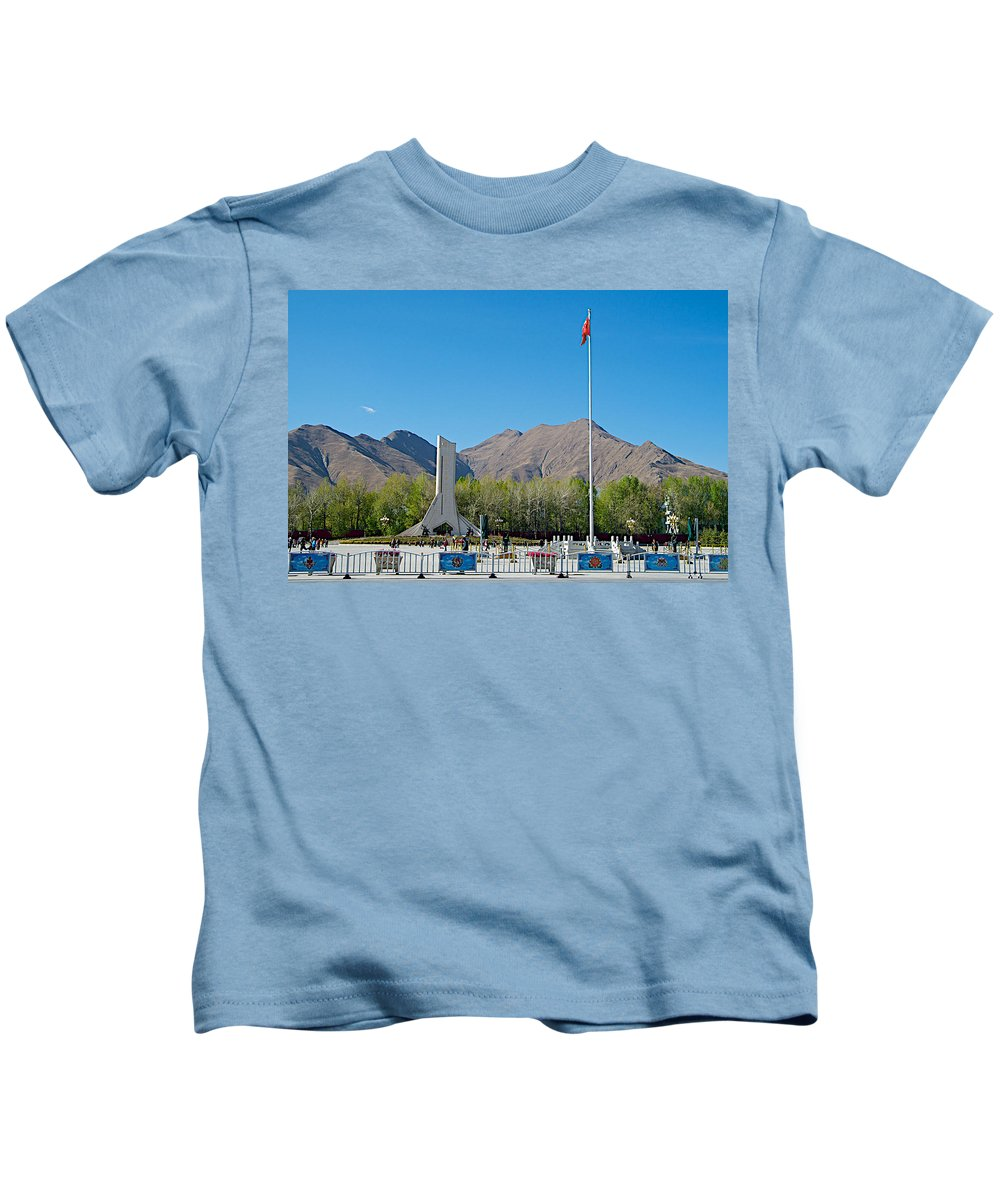 Plaza Across From Potala Palace Which Replaced A Natural Lake In Lhasa Kids T-Shirt featuring the photograph Plaza Across From Potala Palace Which Replaced A Natural Lake-tibet by Ruth Hager