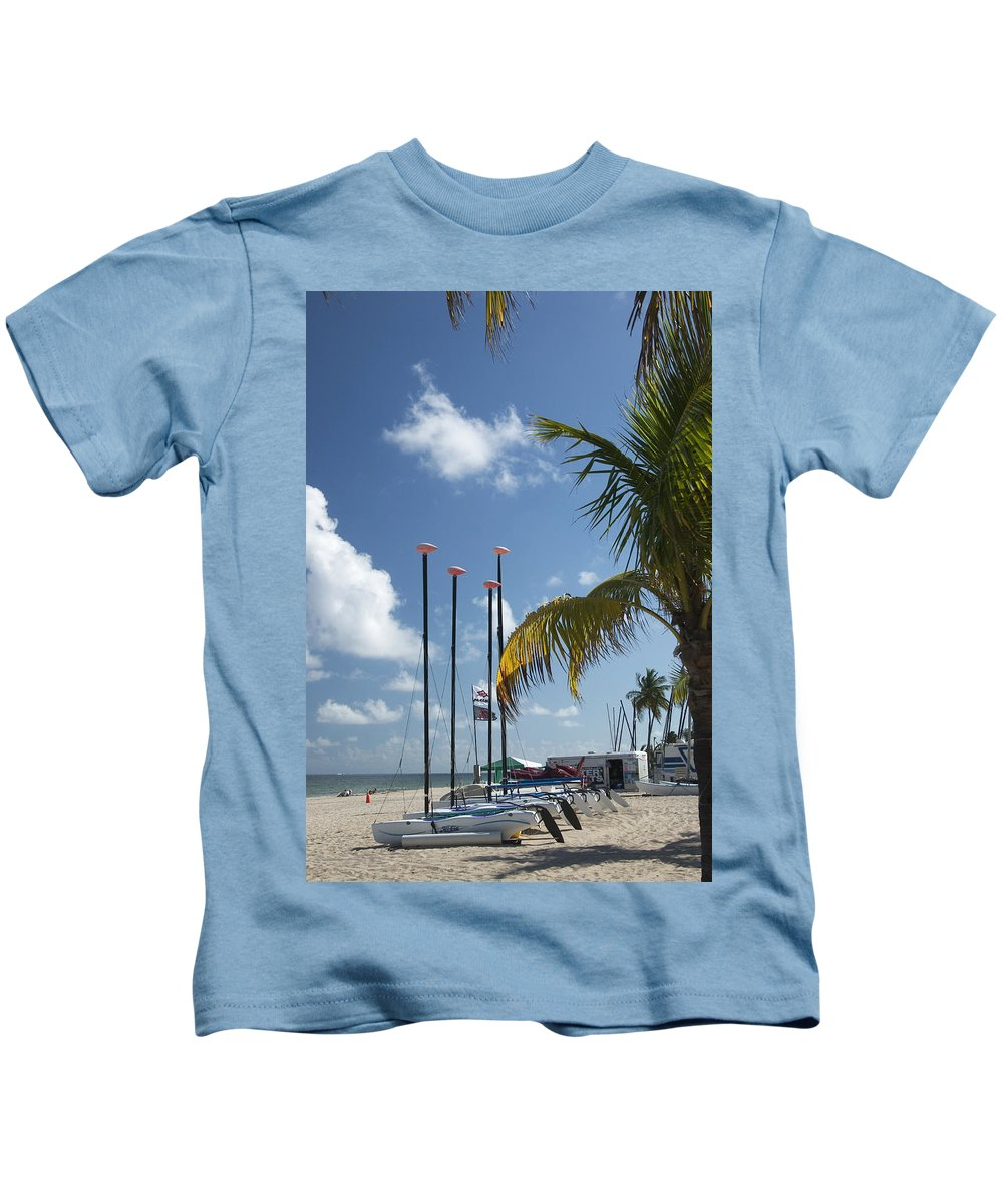 Row Of Sailboats On Beach Kids T-Shirt featuring the photograph Row Of Sailboats by Bob Pardue