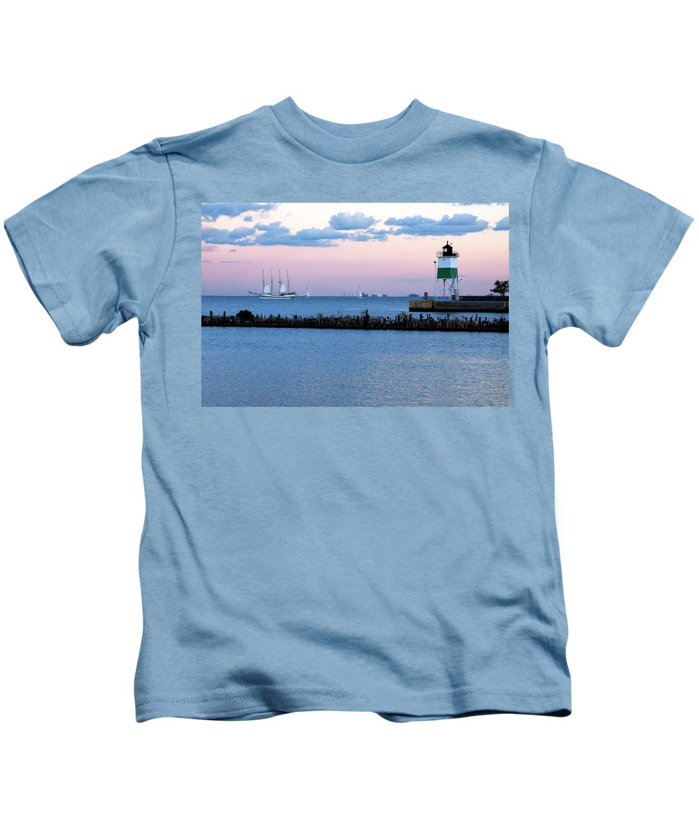 Horizontal Kids T-Shirt featuring the photograph Southeast Guidewall Lighthouse At Sunset And Tall Ship Windy by Sally Rockefeller