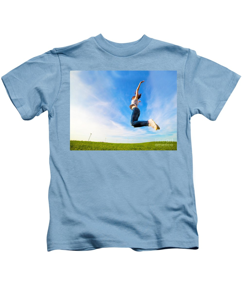 Grass Kids T-Shirt featuring the photograph Young Beautiful Woman Jumping For Joy by Michal Bednarek