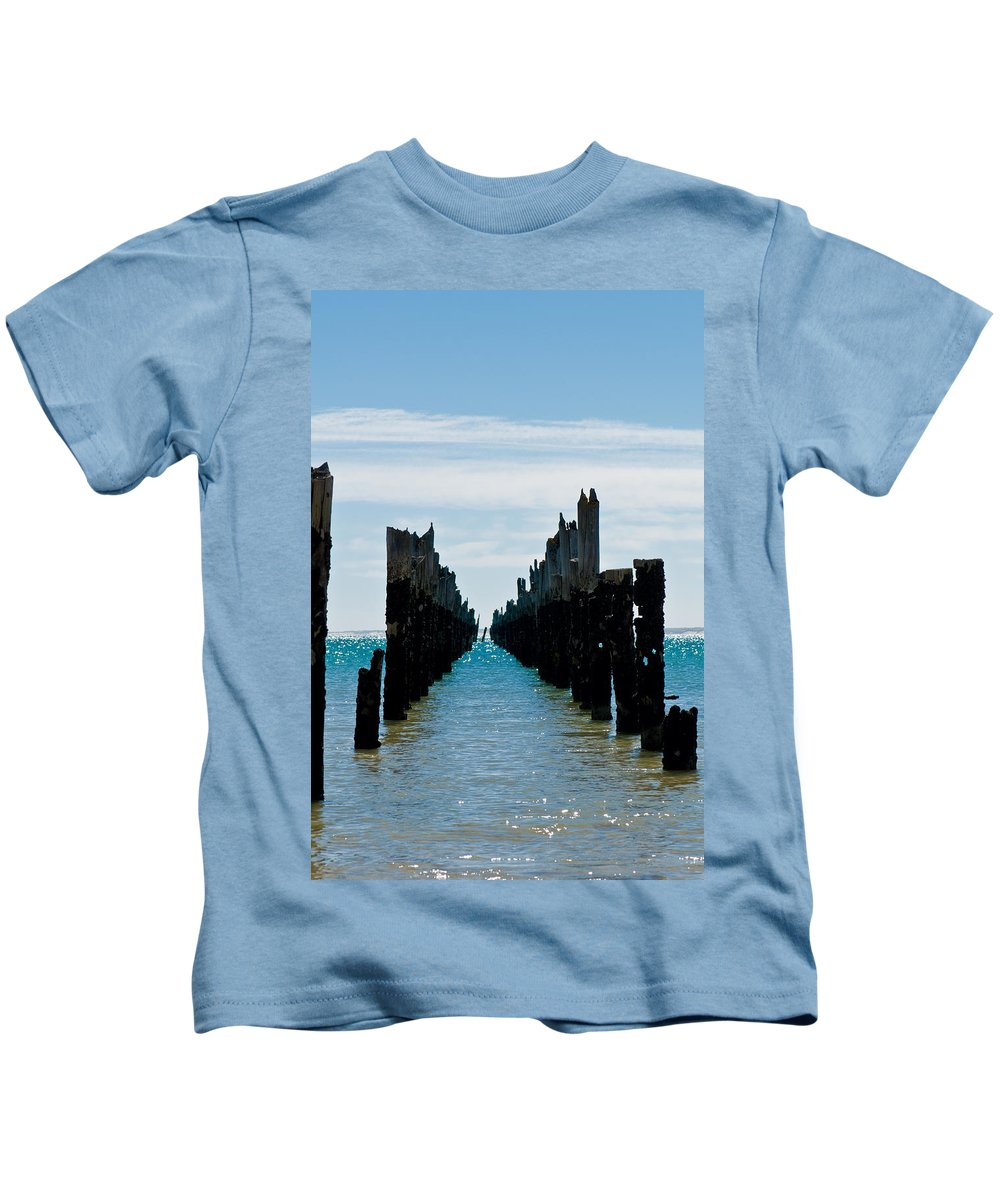 Abstract Kids T-Shirt featuring the photograph Beautiful Rotten Mooring On A Beach Where Only The Pillars Are L by U Schade
