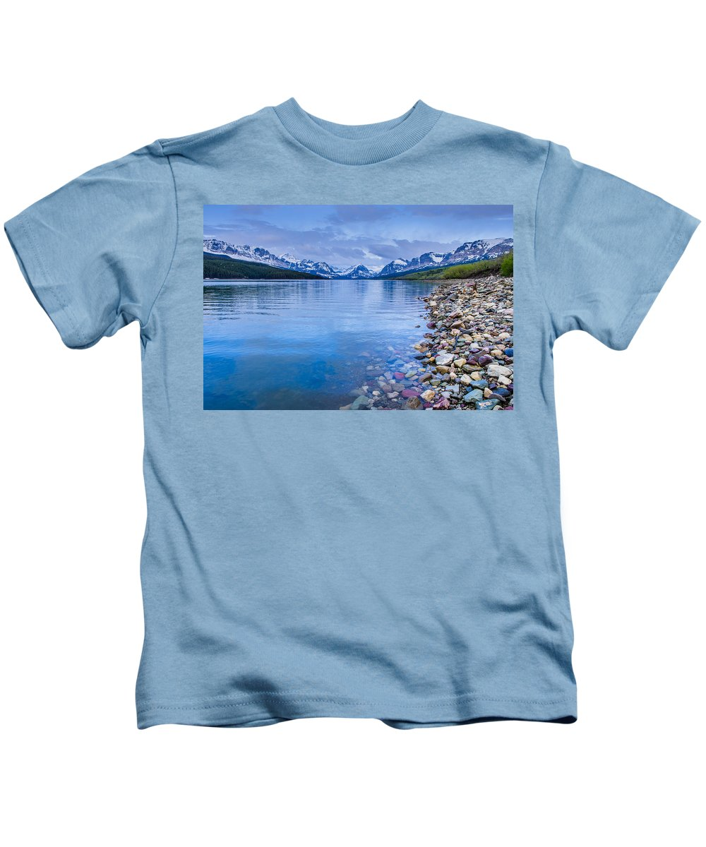 Glacier National Park Kids T-Shirt featuring the photograph Lake Sherburne Shoreline by Greg Nyquist
