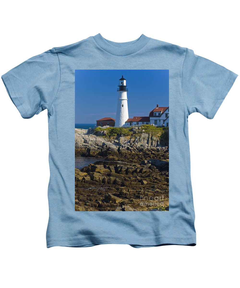 Portland Head Kids T-Shirt featuring the photograph Lighthouse And Rocks by Tim Mulina