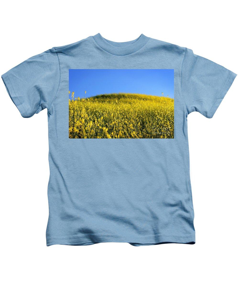 Nature Kids T-Shirt featuring the photograph Mustard Grass by Henrik Lehnerer