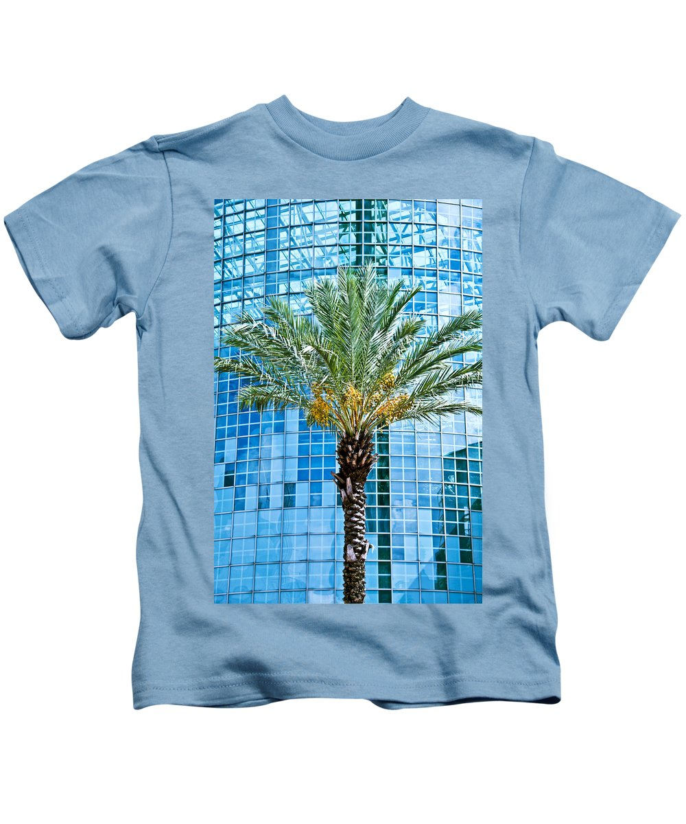 Background Kids T-Shirt featuring the photograph Palme Tree And Blue Building by Ray Laskowitz