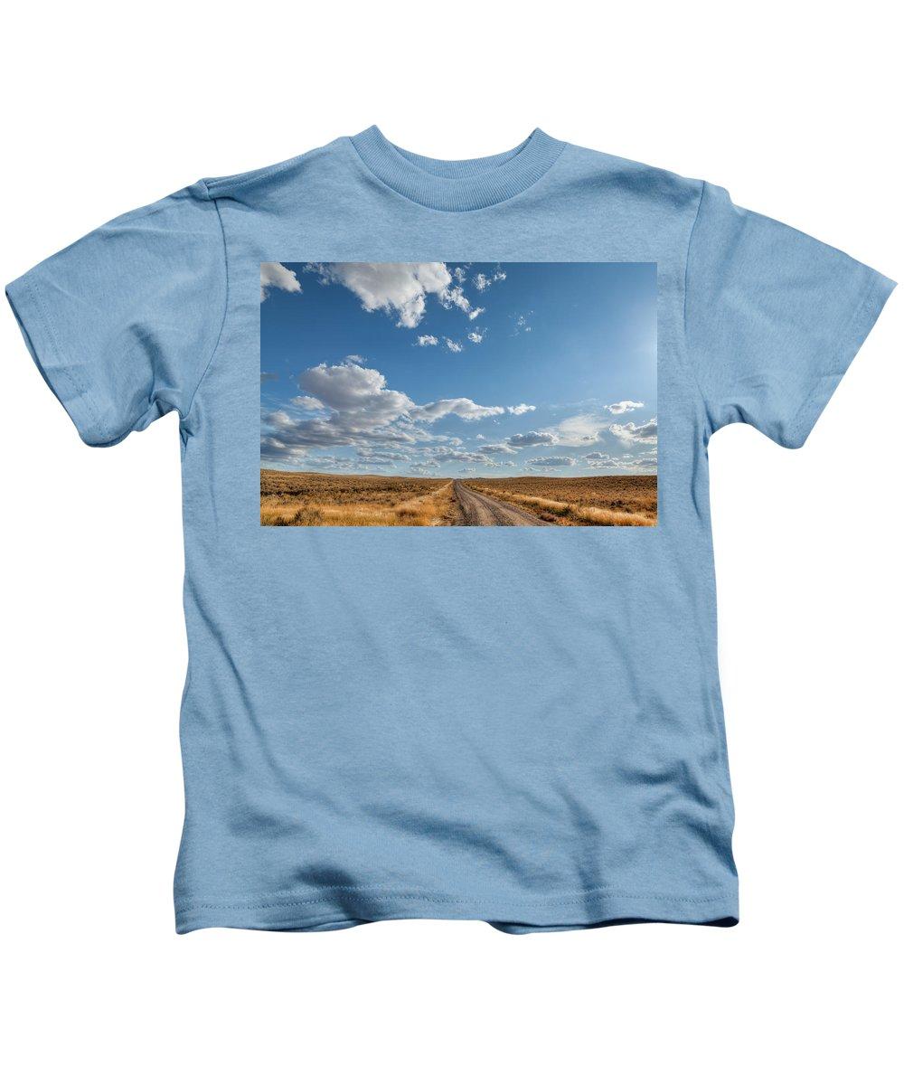 Desert Kids T-Shirt featuring the photograph Road Near Ten Sleep Wyoming by Steve Gadomski