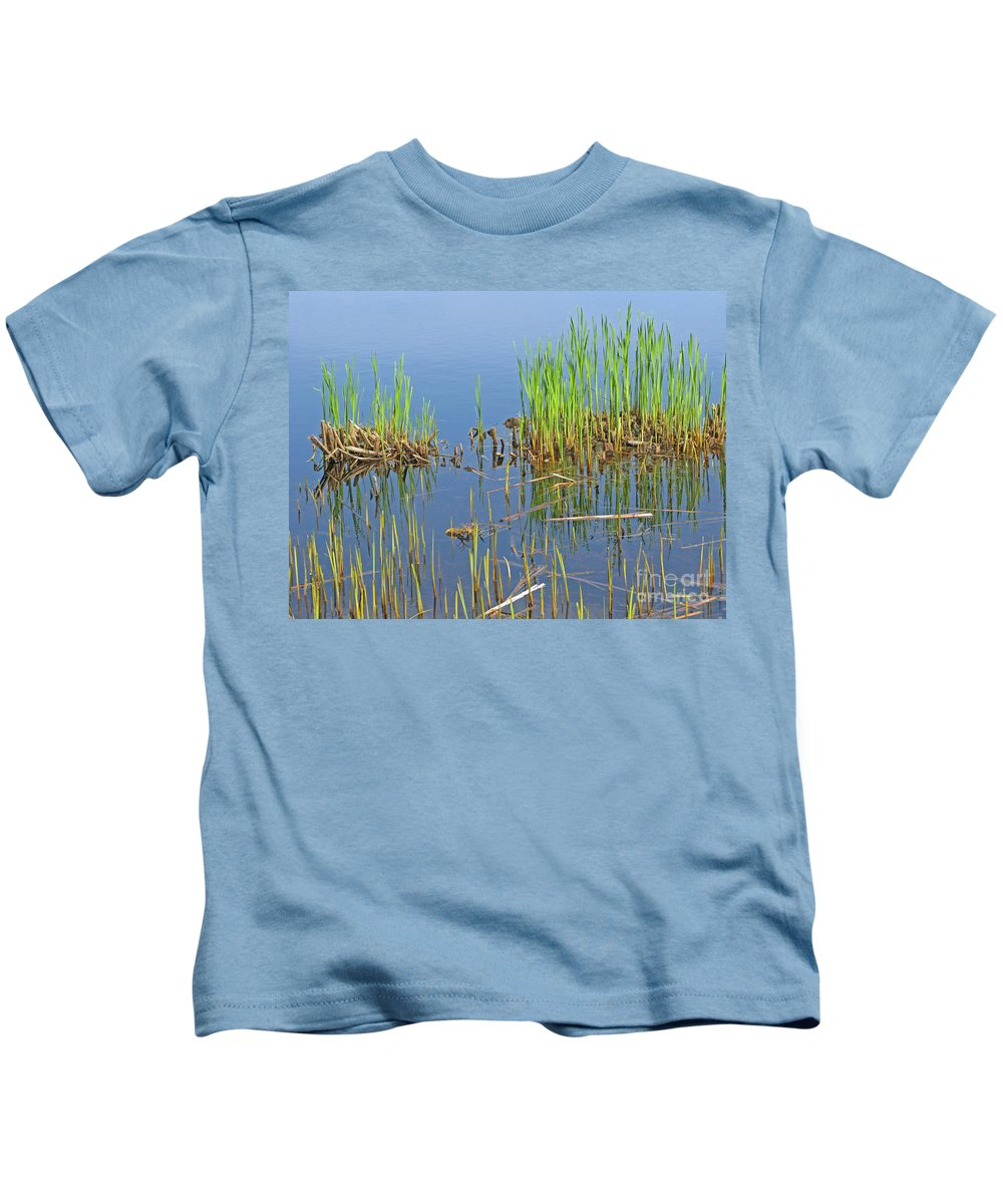 Spring Kids T-Shirt featuring the photograph A Greening Marshland by Ann Horn