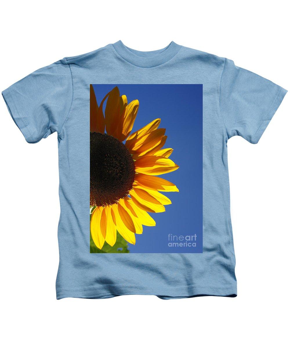 Back Light Kids T-Shirt featuring the photograph Backlit Sunflower by Gaspar Avila