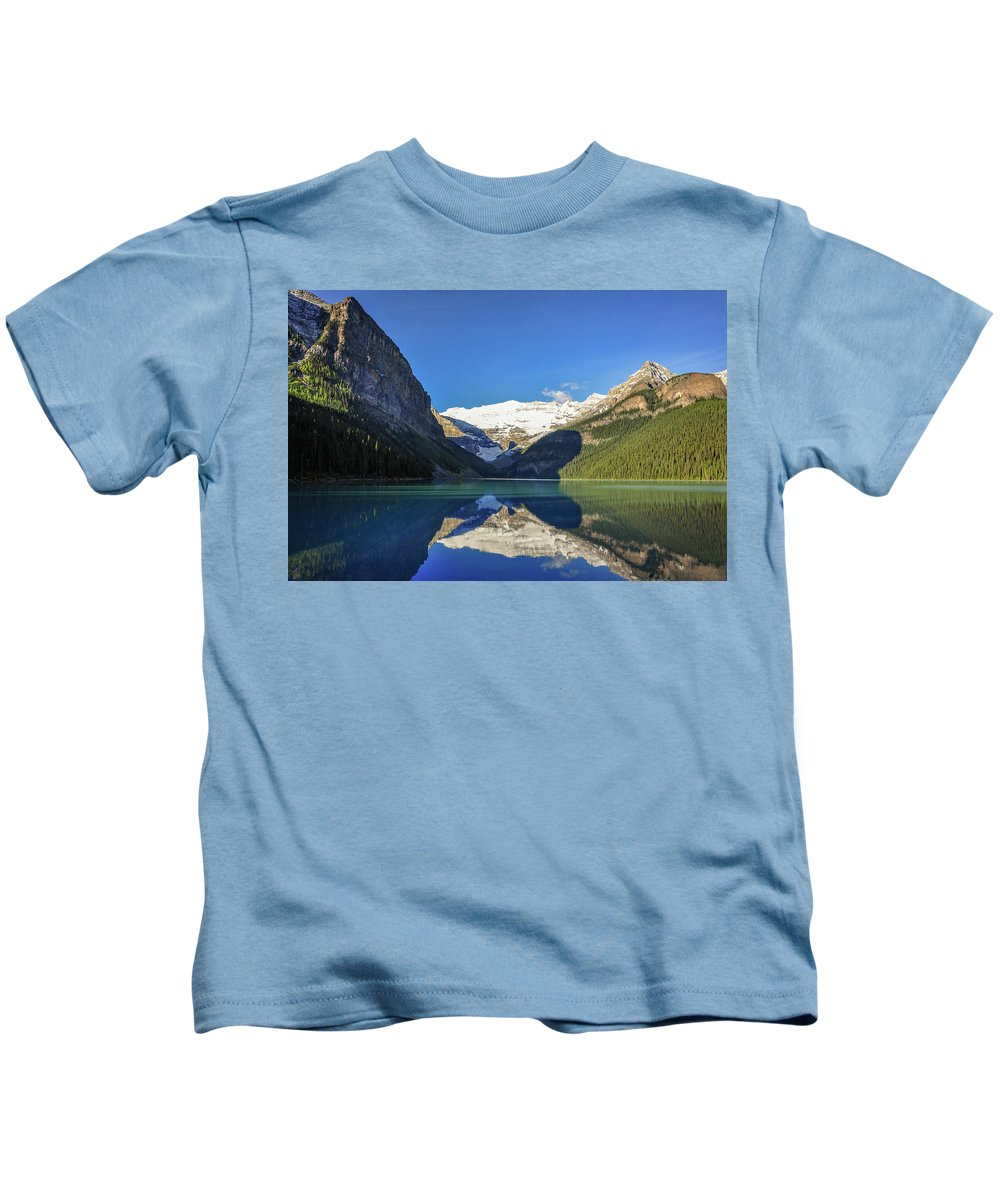 Alberta Kids T-Shirt featuring the photograph Clear Reflections In The Water At Lake Louise, Canada. by Daniela Constantinescu