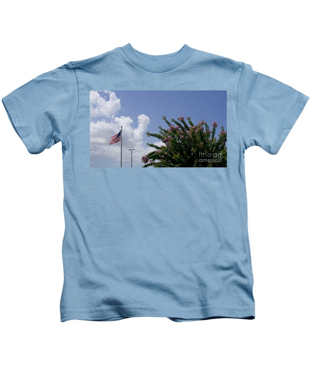 Flag Kids T-Shirt featuring the photograph Flag With Pink Flowers by Allan Hughes