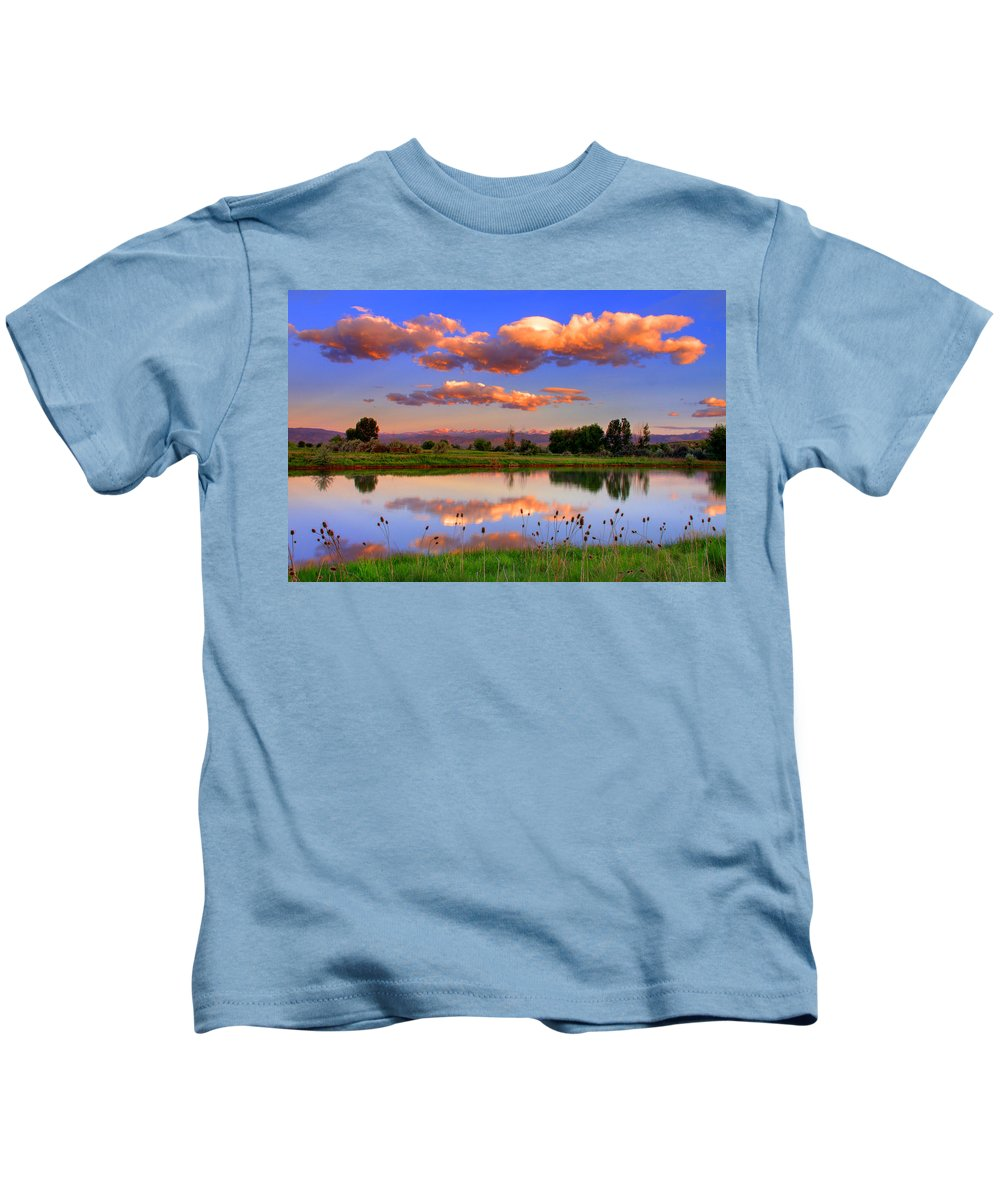 Rocky Mountains Kids T-Shirt featuring the photograph Floating Clouds And Reflections by Scott Mahon