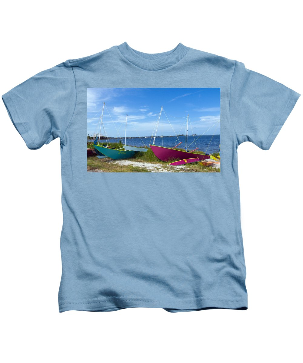 Sail; Sailing; Boat; Sailboat; Mast; Plywood; Homemade; Boy; Scouts; Fleet; Class; Dragon; Tiller; F Kids T-Shirt featuring the photograph Indian River Lagoon On The Easr Coast Of Florida by Allan Hughes