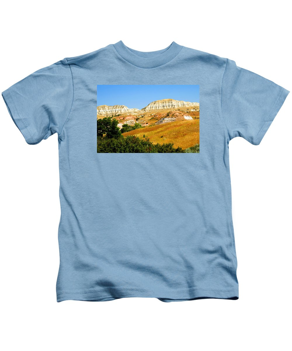 Badlands Kids T-Shirt featuring the photograph North Dakota Badlands by Bill Morgenstern