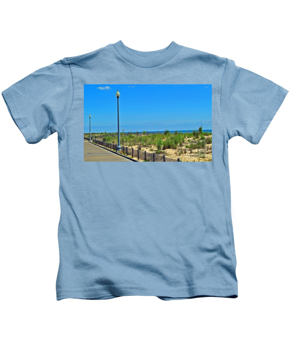 Rehoboth Kids T-Shirt featuring the photograph Posts Of The Sea by Jost Houk