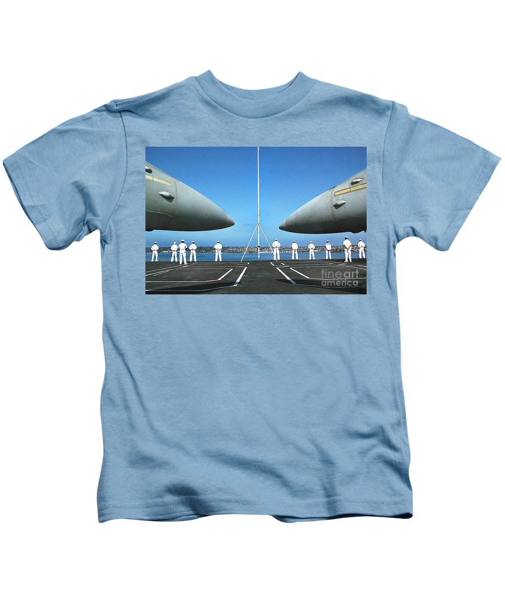 People Kids T-Shirt featuring the photograph Sailors Aboard The Aircraft Carrier Uss Nimitz by R Muirhead Art