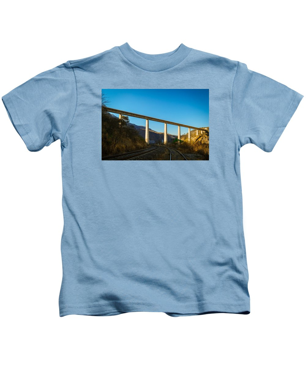 Bridge Kids T-Shirt featuring the photograph The Bridge Over The Railways by Jorge Murguia
