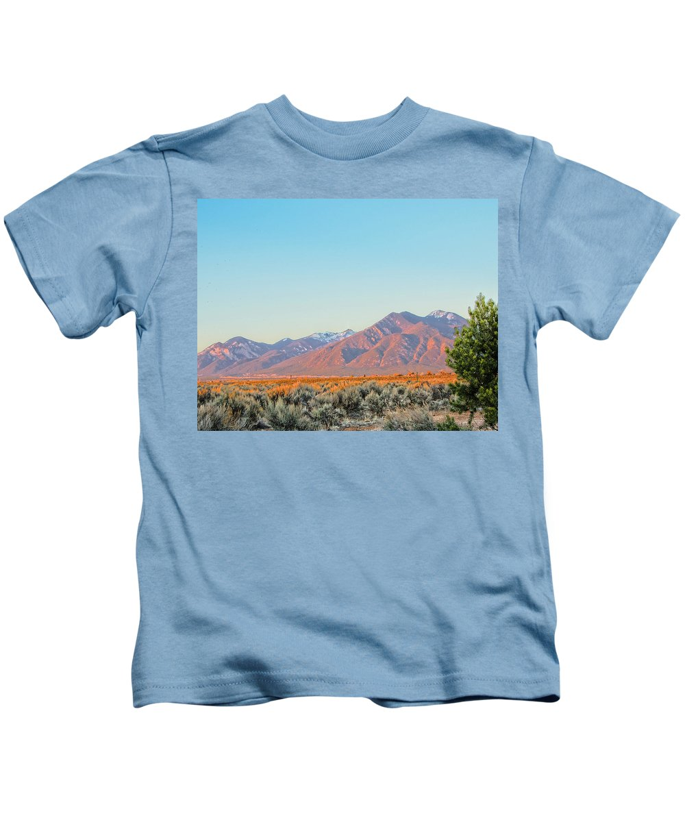 Santa Kids T-Shirt featuring the photograph The Magic Light Of Taos by Charles Muhle