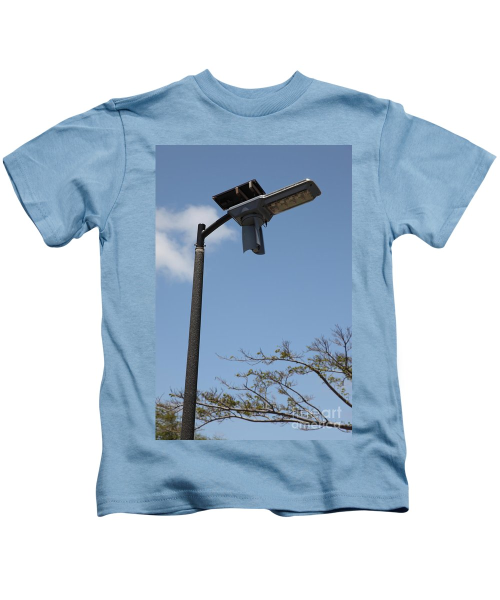 Environment Kids T-Shirt featuring the photograph Wind And Solar Powered Light by Ted Kinsman